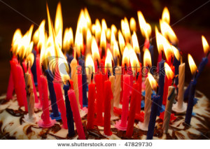 stock-photo-birthday-cake-with-the-lot-of-burning-candles-47829730[1]